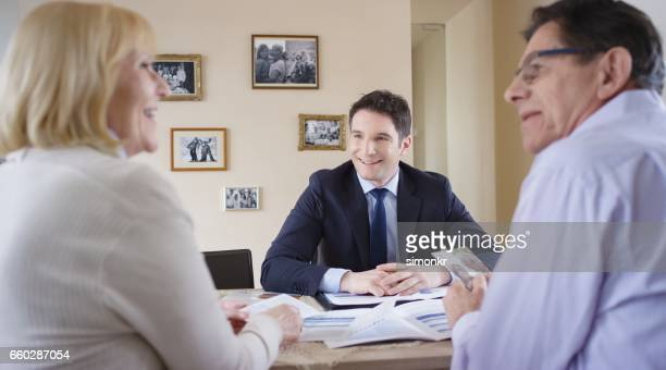 Banker visiting senior couple
