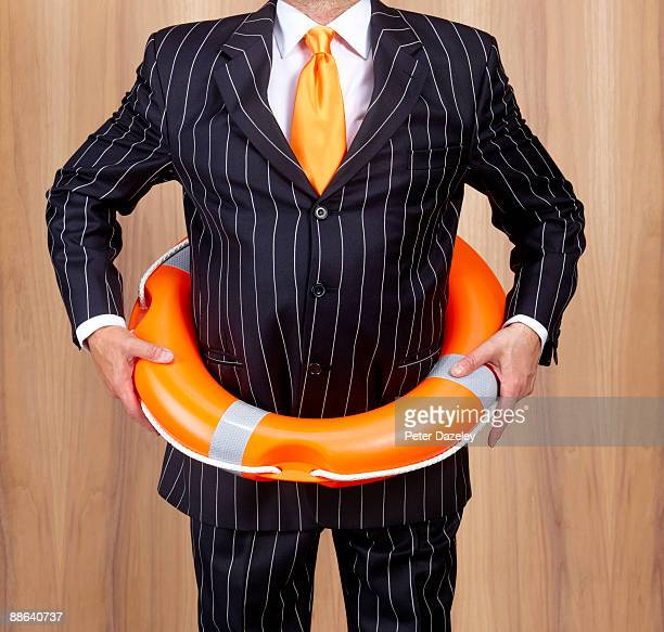 Banker with lifebelt around waist.