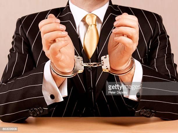 Banker_in_handcuffs.
