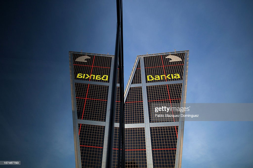 Bankia building at Plaza de Castilla is reflected on a window glass on December 3, 2012 in Madrid, Spain. Spain has formally requested 39.5 euro billions bank bail-out of European funds. Economy Ministry of Spain, Luis de Guindos said that 37 euro billions will be paid for the four nationalized banks Bankia, Catalunya Banc, NCG Banco and Banco de Valencia while 2.5 euro billions will be for the 'bad banks'.