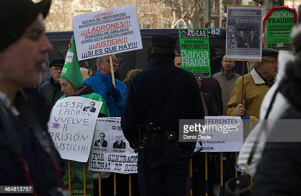 Bankia preferential shareholders protest at a Madrid court where exBankia president Miguel Blesa was giving evidence relating to the collapse of the...