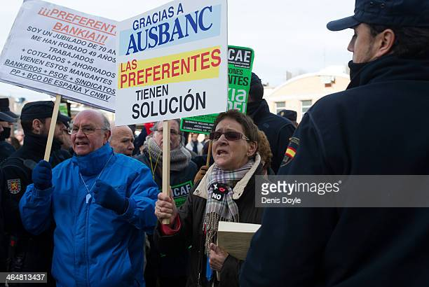 Bankia preferential shareholders protest outside a Madrid court where exBankia president Miguel Blesa was giving evidence relating to the collapse of...