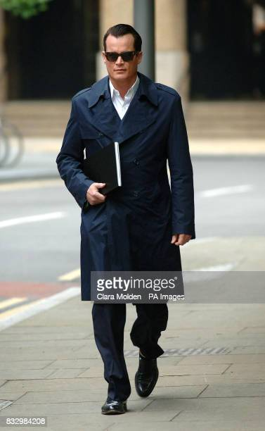 US banking heir Matthew Mellon arrives at Southwark Crown Court in London where he is accused of of spying on his former wife Tamara Mellon who owns...