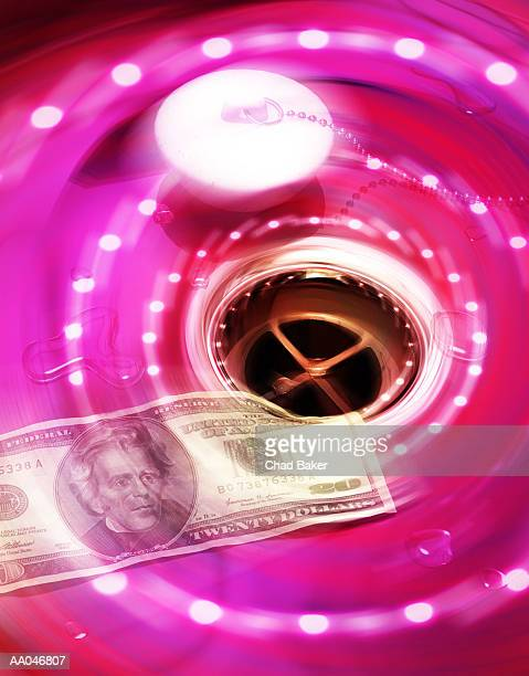 US banknote going down drain, close-up (Digital Composite)
