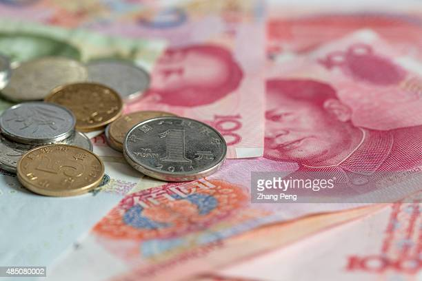 RMB banknotes and coins arranged for photograph China's recent devaluation of the RMB has created waves in domestic and global markets