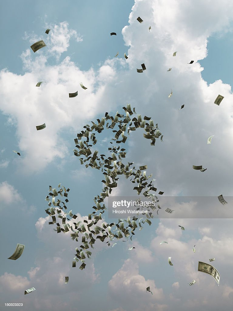 Banknotes are flying in the sky : Stock Photo