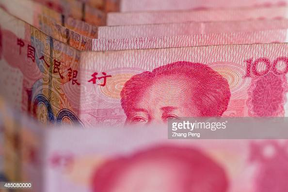 RMB banknotes arranged for photograph China's recent devaluation of the RMB has created waves in domestic and global markets