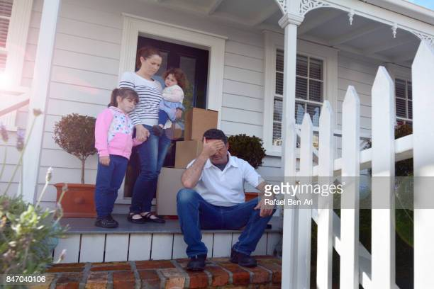 Bankrupt family outside their home