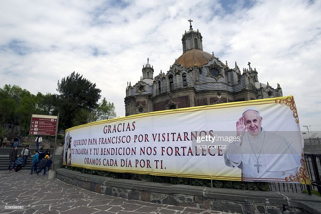 A banner acknowledging Pope Francis is displayed in front of a chapel at 'La Villa' or Basilica de Guadalupe complex where Pope Francis is due to give an open mass-- in Mexico City on February 10, 2016. Pope Francis will visit four Mexican states from next February 12 to 17. AFP PHOTO / YURI CORTEZ / AFP / YURI CORTEZ