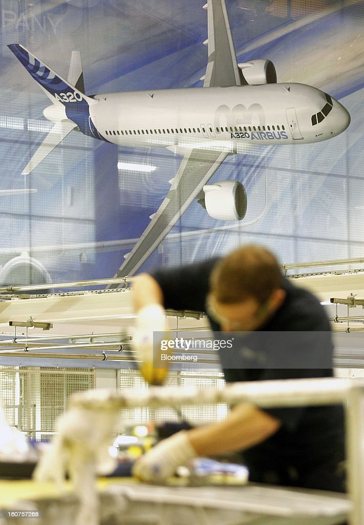 A banner advertises an Airbus A320 neo in the A320 wing assembly section of the company's factory in Broughton, U.K., on Monday, Feb. 4, 2013. Airbus SAS won a $9 billion order from Steven Udvar-Hazy's Air Lease Corp. that includes 25 A350 wide-body jets, a competitor to Boeing Co.'s grounded 787 Dreamliner. Photographer: Paul Thomas/Bloomberg via Getty Images