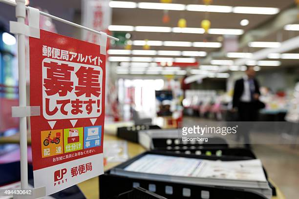 A banner advertises post office parttime jobs at the Japan Post Co post office in Tokyo Japan on Monday Oct 26 2015 Japan Post Holdings and its...