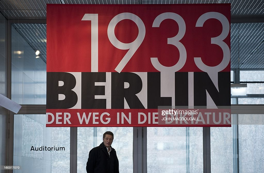 A banner advertises the exhibition 'Berlin 1933 – The Road to Dictatorship' at the Topography of Terror museum in Berlin January 29, 2013. The exhibition highlights key points up until the Summer of 1933. At the same time, it displays victims' biographies within the early stages of NS-Terror, in the months after 30th January 1933. The exhibition coincides with the 80th anniversary of Adolf Hitler's accession to power January 30, 1933. AFP PHOTO / JOHN MACDOUGALL