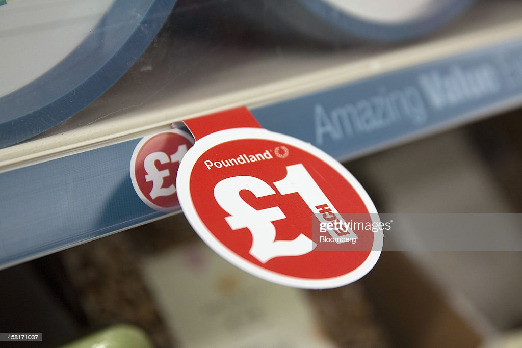 A banner advertises the price of goods on a display shelf inside a Poundland discount store, operated by Poundland Holdings Ltd., in Birmingham, U.K., on Friday, Dec. 20, 2013. U.K. discount retailer Poundland has hired Rothschild to manage its IPO, according to the Sunday Times newspaper. Photographer: Simon Dawson/Bloomberg via Getty Images