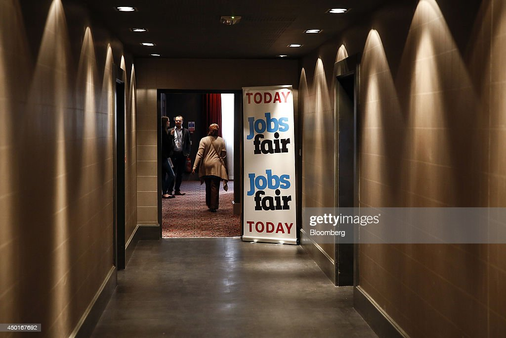 A banner advertising a jobs fair stands outside a conference room at a hotel in Reading UK on Friday June 6 2014 Britain's unemployment rate fell to...