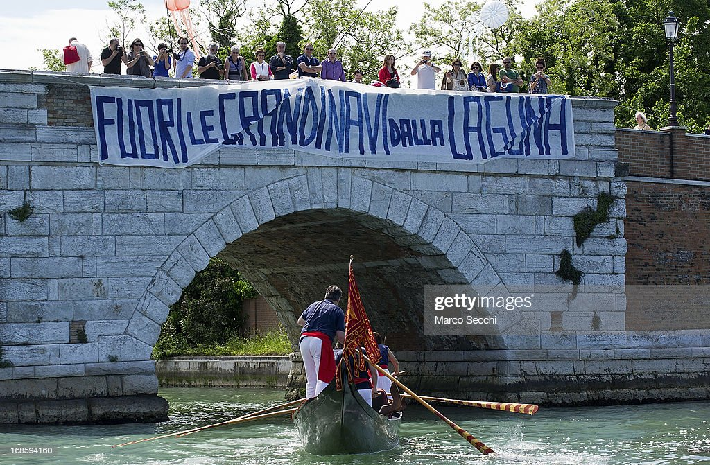 A banner against big cruises is displayed on a bridge during the Sensa Procession on May 12, 2013 in Venice, Italy. The festival of la Sensa is held in May on the Sunday after Ascension Day and follows a reenactment of the traditional ceremony where the Doge (Duke) enacted the wedding of Venice to the sea.