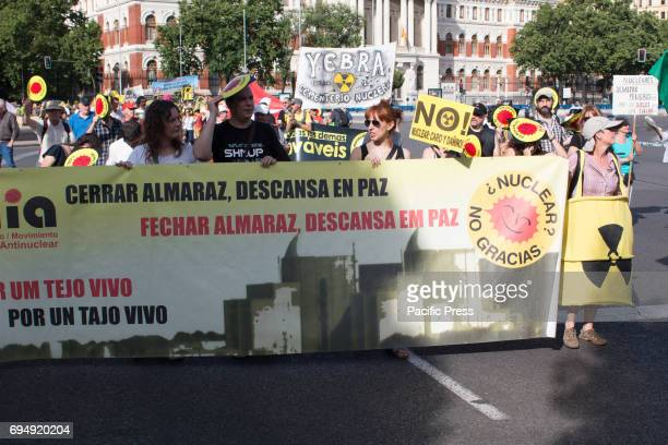 A banner against the Almaraz Nuclear Central Hundreds of people attended the green peace march against nuclear energy