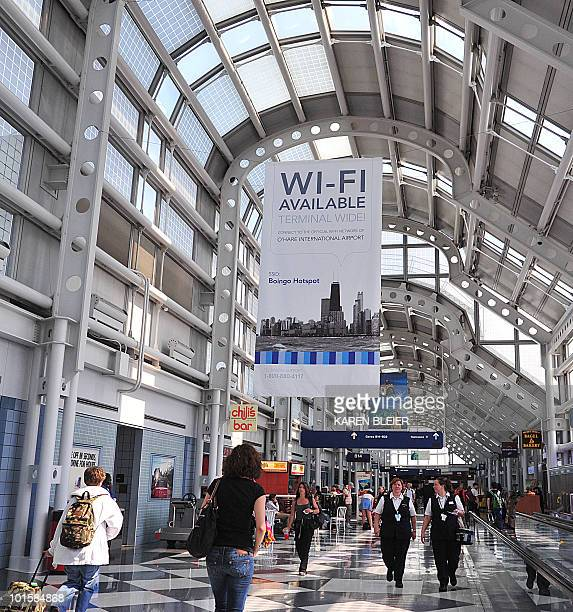 A banner announcing that WiFi is available hangs on a concourse at Chicago's O'Hare International Airport in Chicago Illinois on May 25 2010 AFP...
