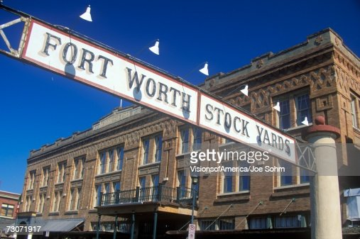 'Banner at the Fort Worth Stock Yards with historic hotel, Ft. Worth, TX'