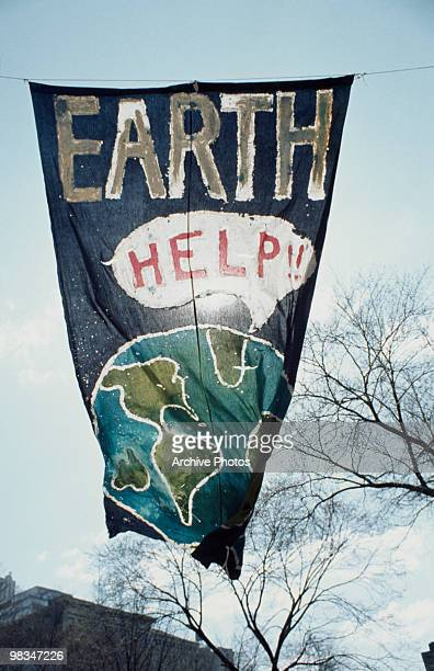 A banner at the inaugural Earth Day depicting the earth calling out for help New York City 22nd April 1970 Earth Day is held annually to raise...