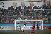 A banner bearing portraits of Palestinian president Mahmud Abbas FIFA outgoing president Sepp Blatter and Palestinian football federation president...