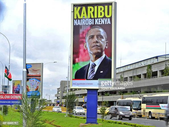 A banner bearing the likeness of the President of the United States Barack Obama and bearing a 'welcome' message hangs over the arrival lounge of the...