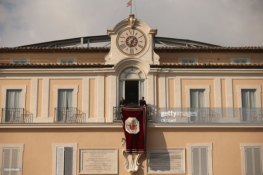 A banner bearing the Papal Seal is unfurled before Pope Benedict XVI waves to pilgrims, for the last time as head of the Catholic Church, from the window of Castel Gandolfo where he will start his retirement today on February 28, 2013 in Castel Gandolfo, Italy. Pope Benedict XVI has been the leader of the Catholic Church for eight years and is the first Pope to retire since 1415. He will stay at the Papal Summer residence of Castel Gandolfo until renovations are complete at a monastery in the grounds of the Vatican and will be known as Emeritus Pope.