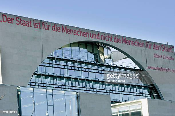 A banner carrying the Albert Einstein quote 'the state is for people and not people for the state' is unveiled at the external wall of the...