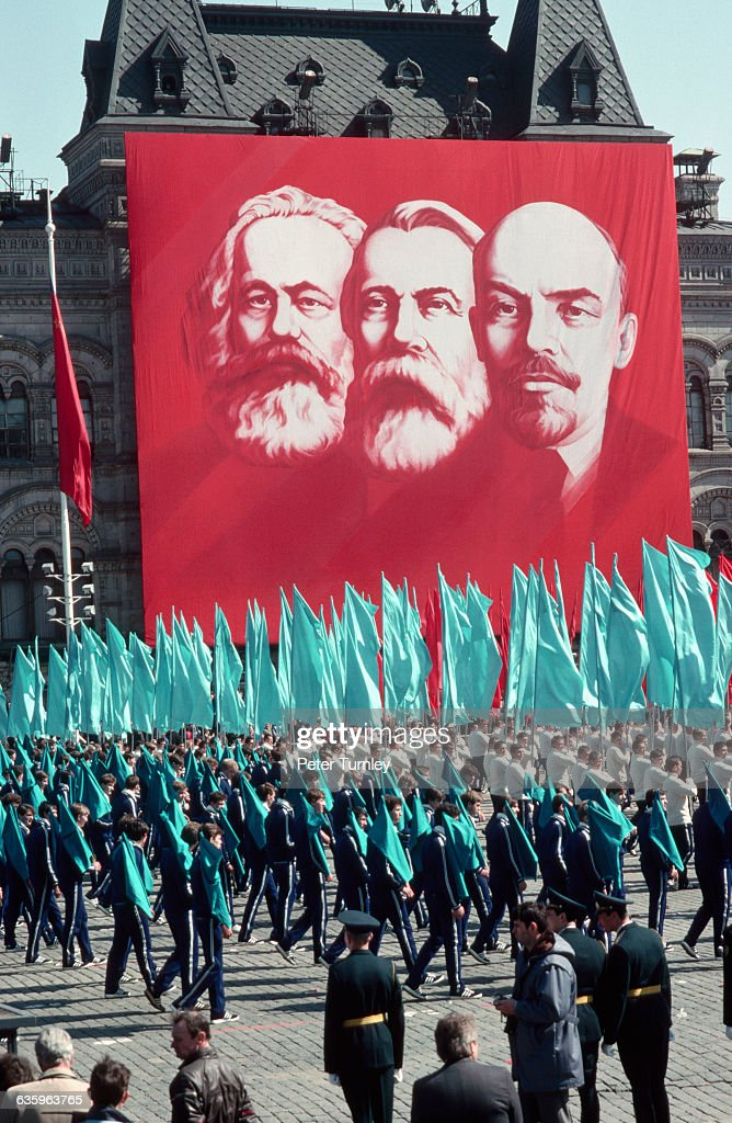 A banner depicting Marx, Engels, and Lenin celebrates the founding fathers of Communism.