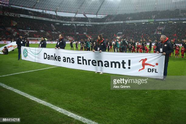 Banner displayed to thank volunteers before the Bundesliga match between Bayer 04 Leverkusen and Borussia Dortmund at BayArena on December 2 2017 in...