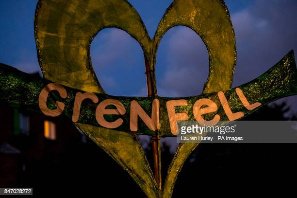 A banner during a silent march for Grenfell Tower fire victims in west London