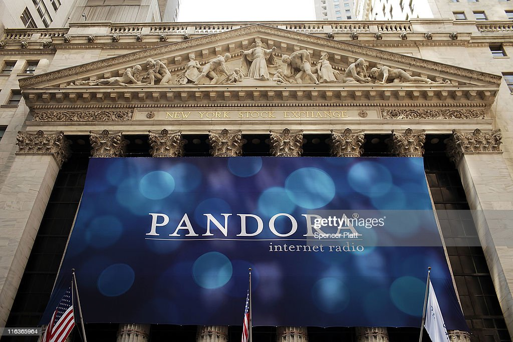 A banner for Pandora Media Inc., the online-radio company, hangs in front of the New York Stock Exchange walk on its first day of trading as a public company on June 15, 2011 in New York City. Pandora stock rose as much as 63 percent to $26 following its debut on the New York Stock Exchange, under the symbol P. Reversing much of the previous day's gains, stocks fell Wednesday as more news emerged about the fragility of the American and global economy. The Dow Jones Industrial Average fell 88 points, or 0.8%, to 11987 in morning trading.