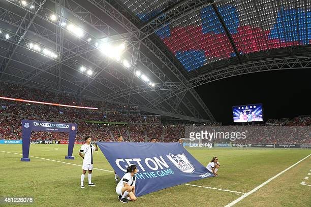 A banner 'Get on with the game' is seen before the Barclays Asia Trophy match between Arsenal and Everton at the National Stadium on July 18 2015 in...
