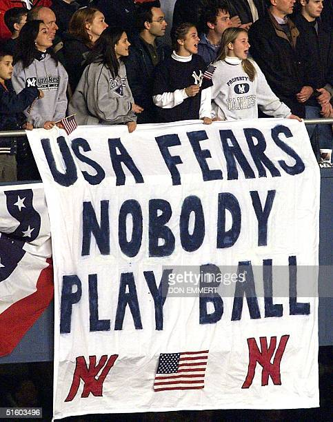 A banner hangs in front of baseball fans during Game 3 of the World Series in New York's Yankee Stadium 30 October 2001 The Arizona Diamondbacks lead...