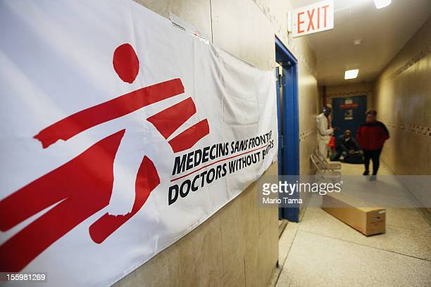 A banner hangs outside a laundry room turned into a makeshift clinic operated by the medical relief organization ''Doctors Without Borders'' in the...