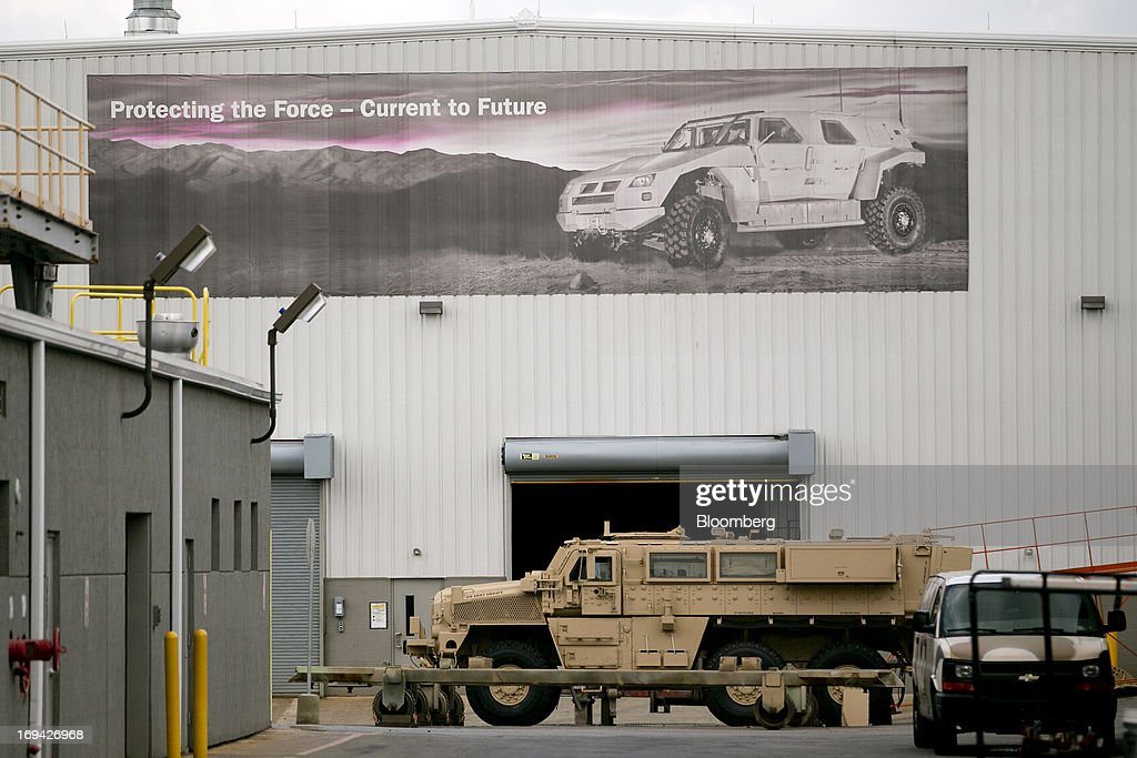 A banner hangs past a Medium Mine Protected Vehicle (MMPV) at the BAE Systems Plc Land & Armaments facility in York, Pennsylvania, U.S., on Thursday, May 23, 2013. BAE Systems Plc is deploying smaller suppliers to pressure U.S. lawmakers to speed up orders to modernize Bradley fighting vehicles, a move the company said may protect thousands of subcontractor jobs and keep a Pennsylvania assembly line open. Photographer: Andrew Harrer/Bloomberg via Getty Images