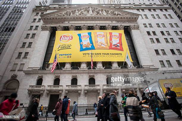 A banner in front of the New York Stock Exchange on Tuesday February 12 2013 promotes Lay's new flavored chips PepsiCo will report results for its...