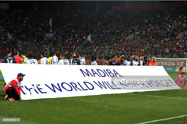 A banner in memory of the late South African president Nelson Mandela is displayed at the stadium prior to UEFA Champions league football match...