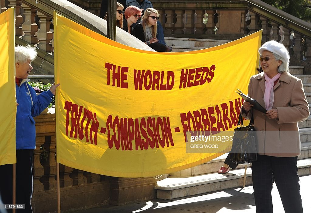 A banner is displayed as practitioners of spiritual movement Falungong gather at Sydney's Town Hall Square on July 20, 2012. The group intends to present an open letter to the Sydney office of Australian Prime Minister Julia Gillard urging her to denounce what they say is a 13-year-long persecution of the spiritual practice in China. Falungong -- a movement loosely based on Buddhist, Taoist and Confucian philosophies -- enjoyed growing popularity among the Chinese in the 1990s, but was banned by China in 1999 after thousands of practitioners silently converged in Beijing to air their grievances, showing their organizational might. AFP PHOTO / Greg WOOD