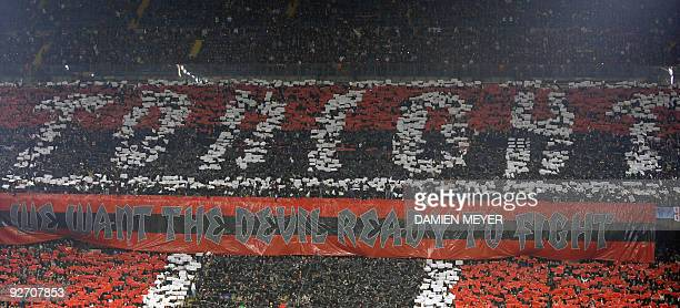 A banner is displayed during the UEFA Champions League group stage football match AC Milan vs Real Madrid on November 3 2009 at San Siro stadium in...