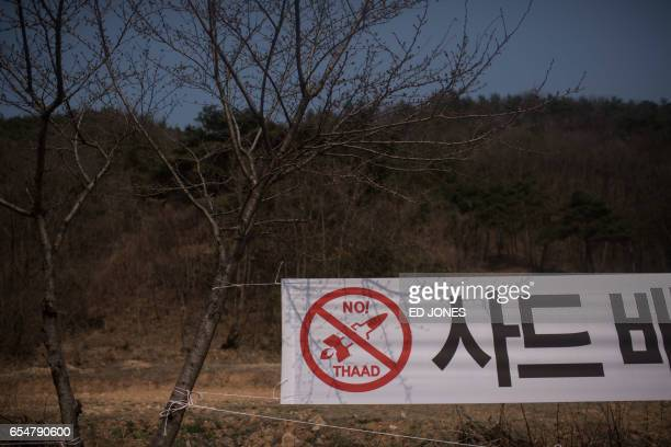 A banner is displayed outside a golf course being used as the site for the recently installed US Terminal High Altitude Area Defense system in...