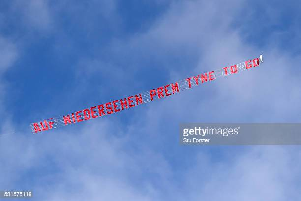 A banner is flown over the stadium with Newcastle relegated during the Barclays Premier League match between Newcastle United and Tottenham Hotspur...