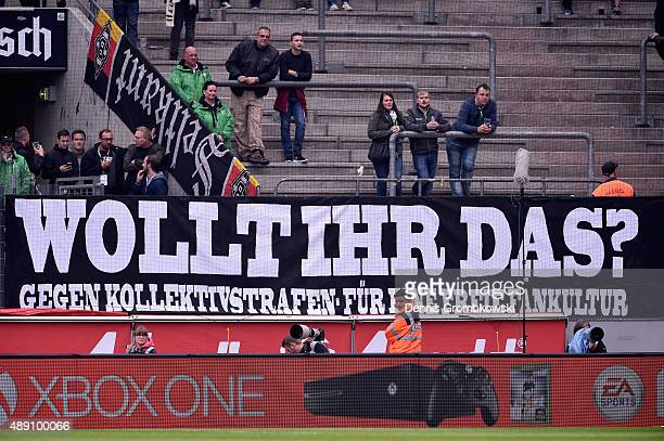 A banner is seen in the Borussia Moenchengladbach supporters stands during the Bundesliga match between 1 FC Koeln and Borussia Moenchengladbach at...