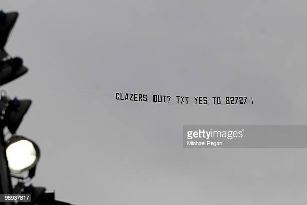 A banner is towed by a plane above the stadium during the Barclays Premier League match between Manchester United and Stoke City at Old Trafford on...