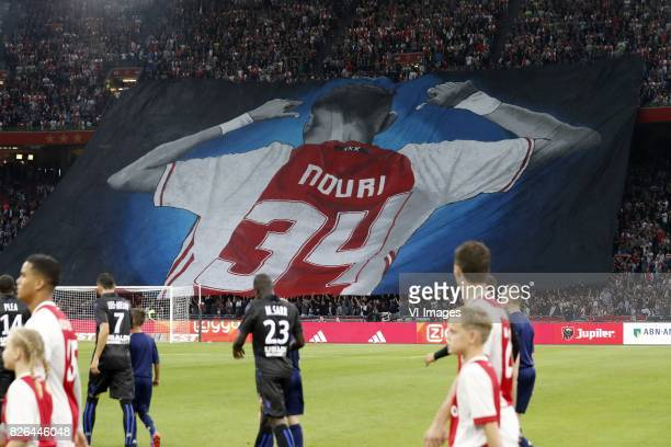 banner of Abdelhak Nouri of Ajax during the UEFA Champions League third round qualifying first leg match between Ajax Amsterdam and OGC Nice at the...