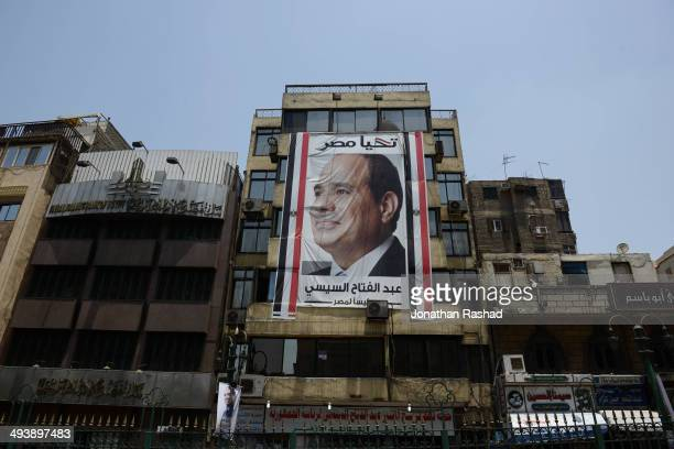 A banner of candidate Abdel Fattah alSisi on display in the Gamaliya suburb of Cairo on May 26 2014 in Cairo Egypt Egypt will hold Presidential...