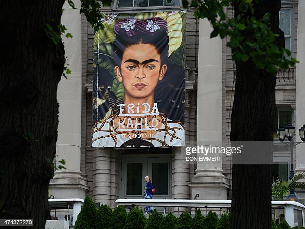 A banner of Frida Kahlo's 'SelfPortrait with Thorn Necklace and Hummingbird' hangs over the entrance of the Mertz Library advertising the 'Frida...