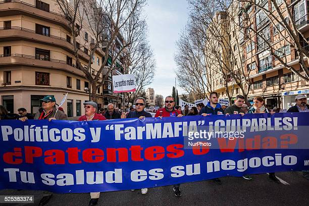 Banner of protesters against government and pharma companies corruption in the demonstration on March 1 2015 in Madrid for support of hepatitis C...