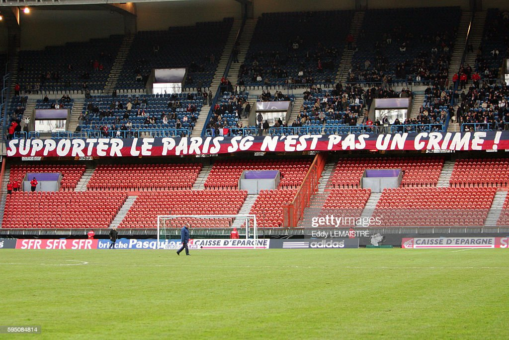 Banner of PSG fans reading 'Supporting PSG is not a crime' before the French Cup match between Paris Saint Germain and FC Gueugnon