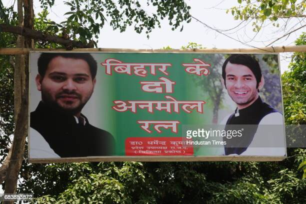 Banner of Tejaswi and Tejpratap Yadav outside RJD Chief Lalu Prasad's residence during income tax raid on May 16 2017 in Patna India The Income Tax...