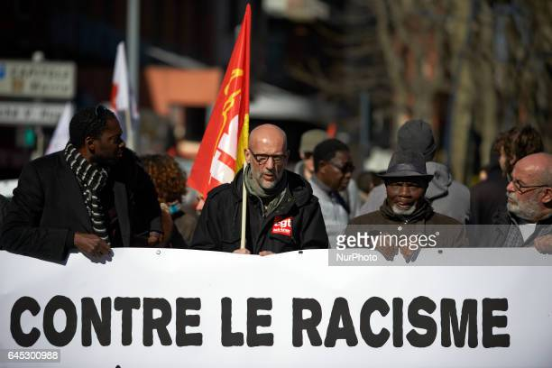 A banner reading 'Against racism' during a march in protest against police violence after the alleged rape with a truncheon of Theo Luhaka by four...